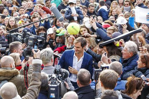 Switzerland's Roger Federer, centre, poses for a selfie with supporters, during a pre-event of the Laver Cup, in Geneva, Switzerland, Friday, February 8, 2019. (Salvatore Di Nolfi/Keystone via AP)