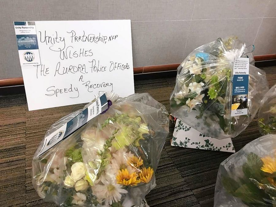 Unity Partnership delivered seven flower arrangements Thursday to Aurora police to thank the six officers who were injured in the shooting Feb. 15 at Henry Pratt Co. as well as Chief Kristen Ziman.