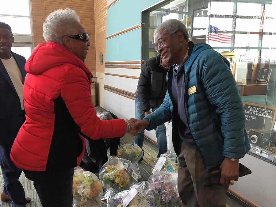 Regina Brent, president and founder of Unity Partnership, greets Bob Mathis, treasurer of the DuPage County NAACP, Thursday as both visit the Aurora police headquarters to show support for the department's response to the shooting Feb. 15 at Henry Pratt Co.