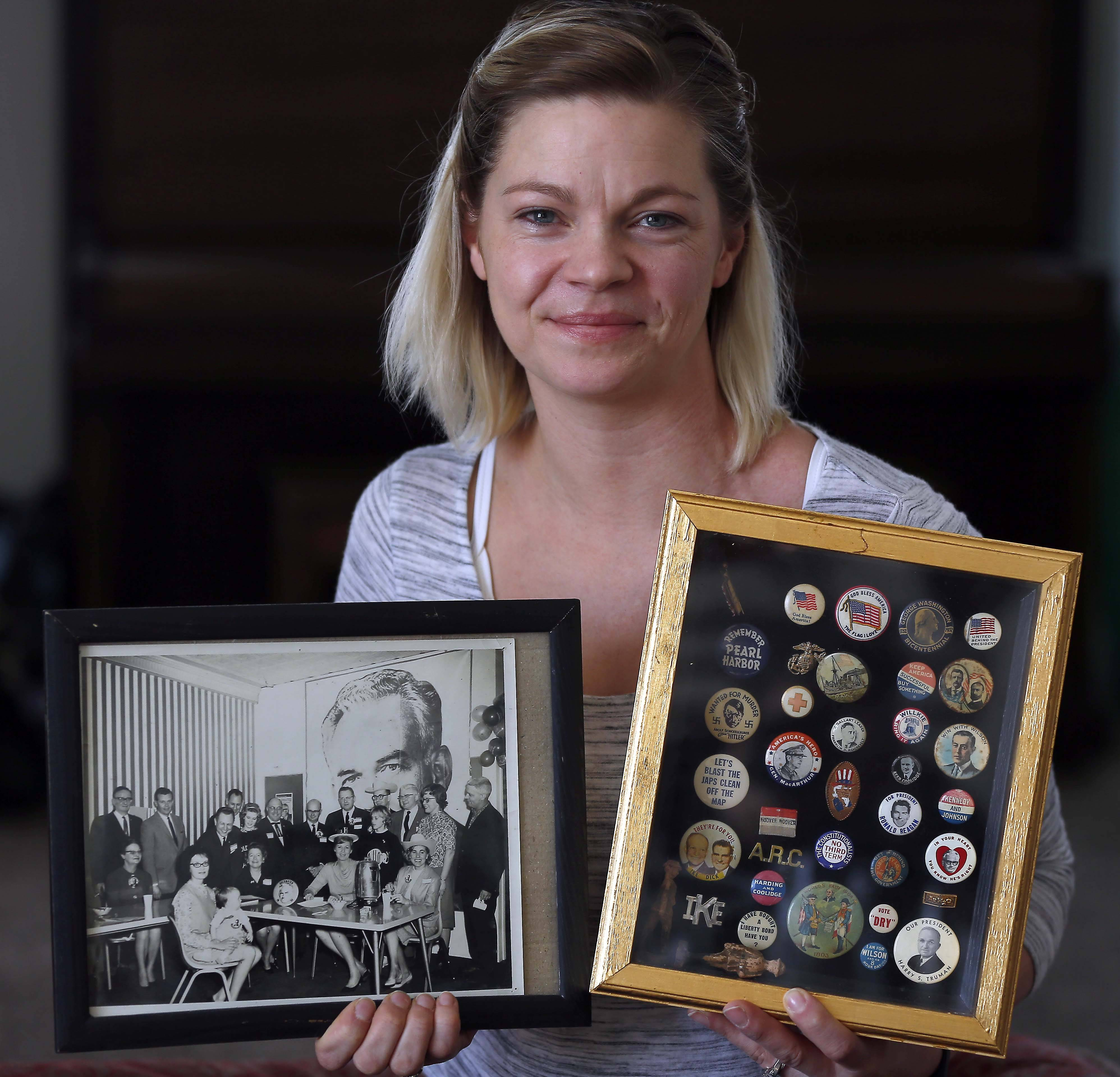 In her right hand is a photograph featuring several relatives among the campaign workers for 1964 Republican presidential candidate Barry Goldwater. In her left is her mother's collection of antique political buttons. But Laura Carlson Spencer says the button collection given to her by her grandparents accidentally was donated to Goodwill during her recent move from St. Charles to Elburn. On Wednesday, buyer Frank Mazza brought them back.