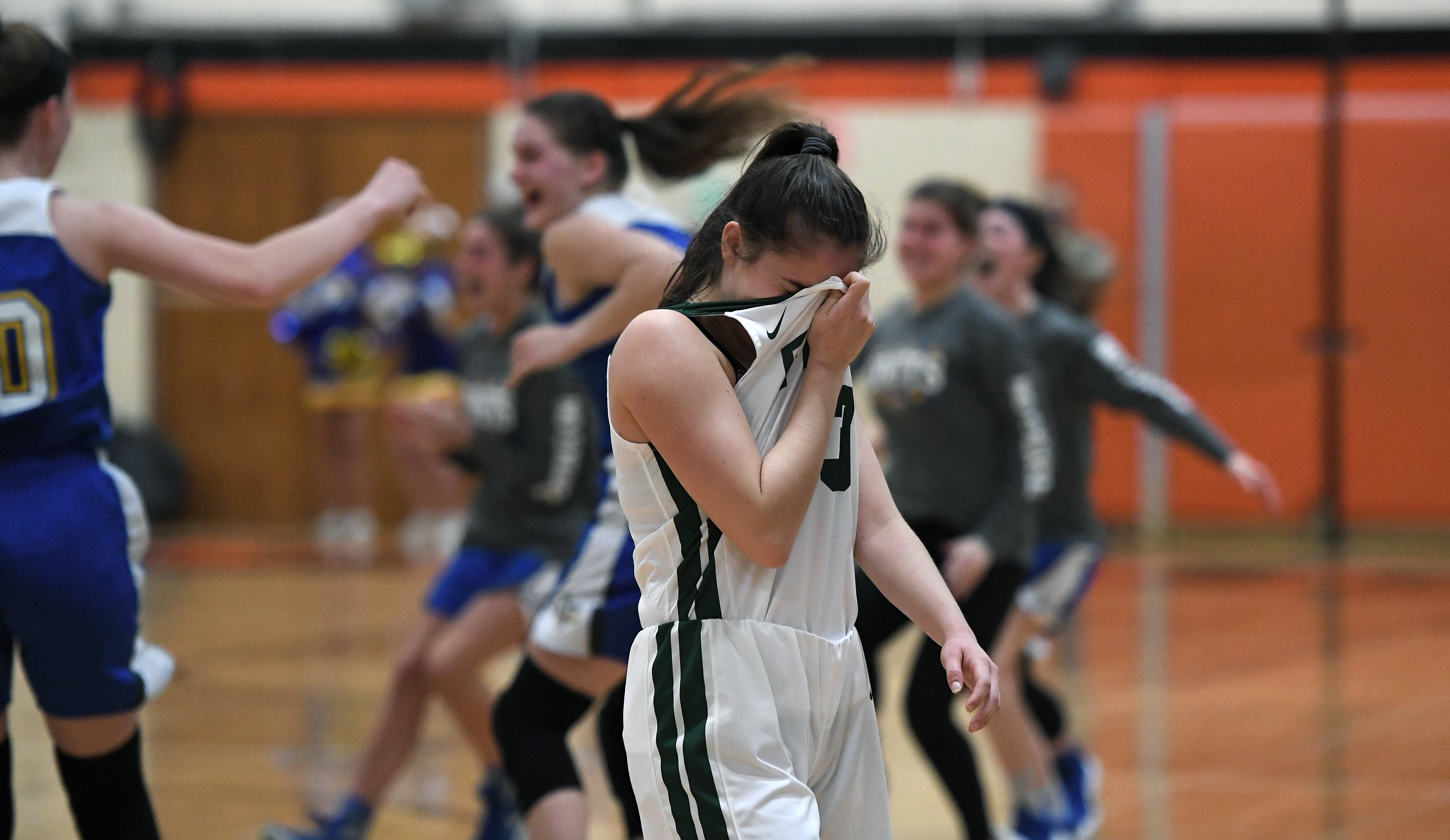 Fremd's Angie Zara feels the sting of the Vikings' loss to Lake Forest in the IHSA girls basketball sectional final in Libertyville on Thursday.