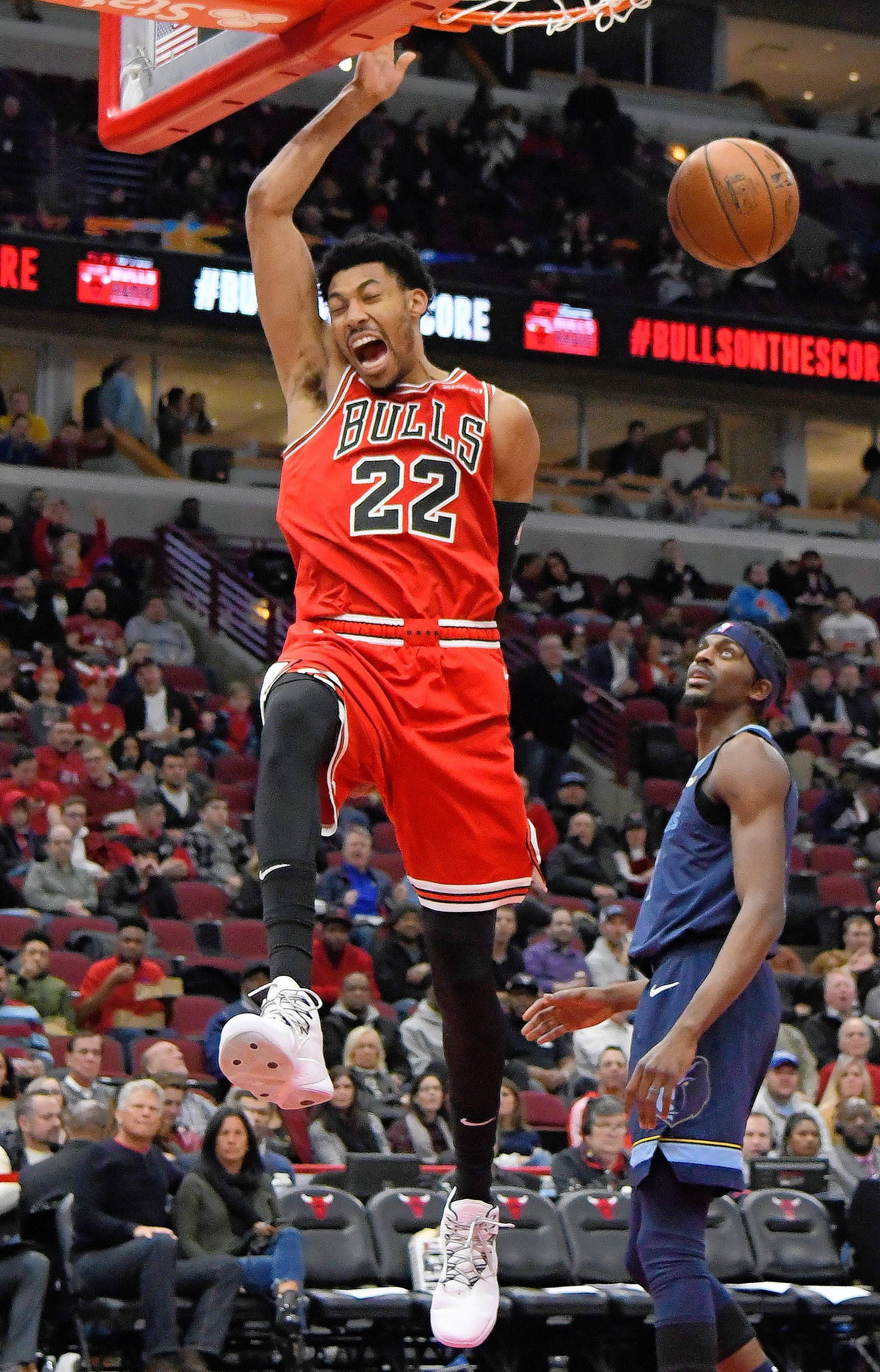 Bulls forward Otto Porter Jr. reacts after dunking the ball as Memphis Grizzlies forward Justin Holiday stands nearby during Chicago's 122-110 victory at home Wednesday. Porter was known to be inconsistent with the Washington Wizards, but he's been great in his first four games as a Bull.
