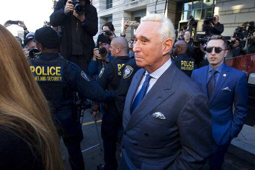 Former campaign adviser for President Donald Trump, Roger Stone, leaves federal court Thursday, Feb. 21, 2019, in Washington. A judge has imposed a full gag order on Trump confidant Roger Stone after he posted a photo on Instagram of the judge with what appeared to be crosshairs of a gun.