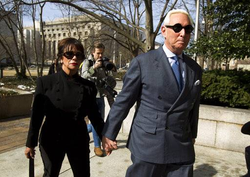 Former campaign adviser for President Donald Trump, Roger Stone accompanied by his wife Nydia Stone, left, arrives at federal court in Washington, Thursday, Feb. 21, 2019. Stone was ordered to appear in court over a Instagram post he made about U.S. Judge Amy Berman Jackson.