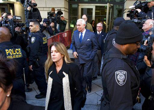 Former campaign adviser for President Donald Trump, Roger Stone leaves the federal court in Washington, Thursday, Feb. 21, 2019, as his daughter Adria, Stone walks in front of him.