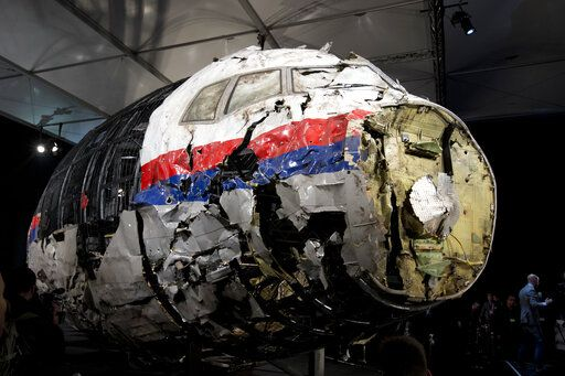 FILE - This Tuesday, Oct. 13, 2015 file photo, shows the reconstructed wreckage of Malaysia Airlines Flight MH17, put on display during a press conference in Gilze-Rijen, central Netherlands. Malaysia Airlines Flight 17 broke up high over Eastern Ukraine killing all 298 people on board. A Dutch safety watchdog says airlines around the world need more and better information to make risk assessments about flying over conflict zones. The Dutch Safety Board issued a report Thursday Feb. 21, 2019, following up on its publication in 2015 of a probe into the cause of the downing of Malaysia Airlines Flight 17 over war-ravaged eastern Ukraine on July 17, 2014.
