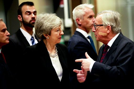 European Commission President Jean-Claude Juncker, right, speaks with British Prime Minister Theresa May prior to a meeting at EU headquarters in Brussels, Wednesday, Feb. 20, 2019. European Commission President Jean-Claude Juncker and British Prime Minister Theresa May meet Wednesday for their latest negotiating session to seek an elusive breakthrough in Brexit negotiations.