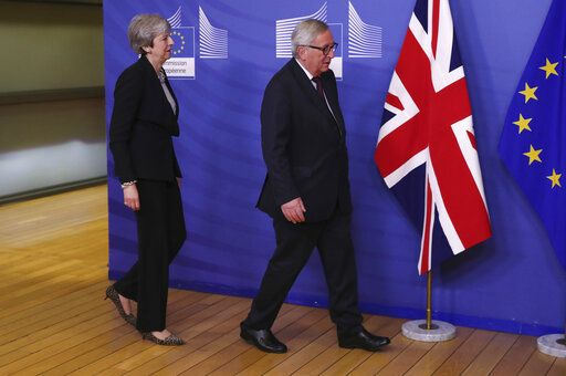 British Prime Minister Theresa May, left, walks with European Commission President Jean-Claude Juncker prior to a meeting at EU headquarters in Brussels, Wednesday, Feb. 20, 2019. European Commission President Jean-Claude Juncker and British Prime Minister Theresa May meet Wednesday for their latest negotiating session to seek an elusive breakthrough in Brexit negotiations.