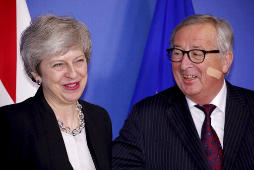 British Prime Minister Theresa May, left, is greeted by European Commission President Jean-Claude Juncker prior to a meeting at EU headquarters in Brussels, Wednesday, Feb. 20, 2019. European Commission President Jean-Claude Juncker and British Prime Minister Theresa May meet Wednesday for their latest negotiating session to seek an elusive breakthrough in Brexit negotiations.