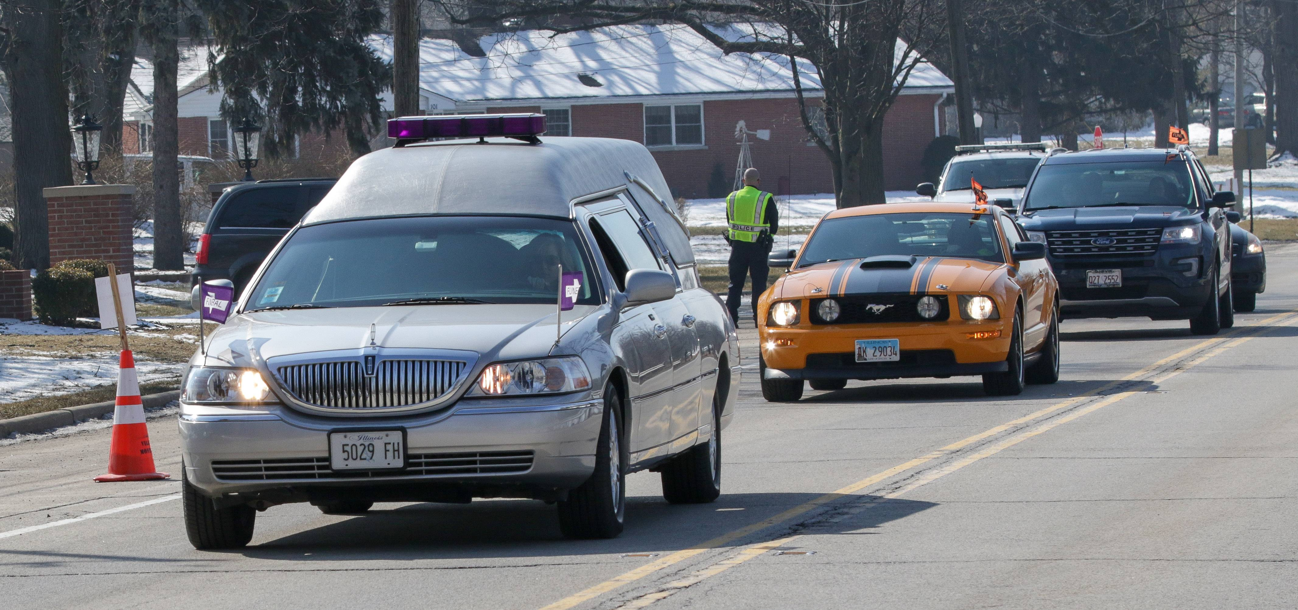 The funeral procession of Russell Beyer, of Yorkville, leaves Dieterle Memorial Home in Montgomery Friday. Beyer was among five Henry Pratt employees killed by a co-worker on Feb. 15 at the manufacturing plant in Aurora.