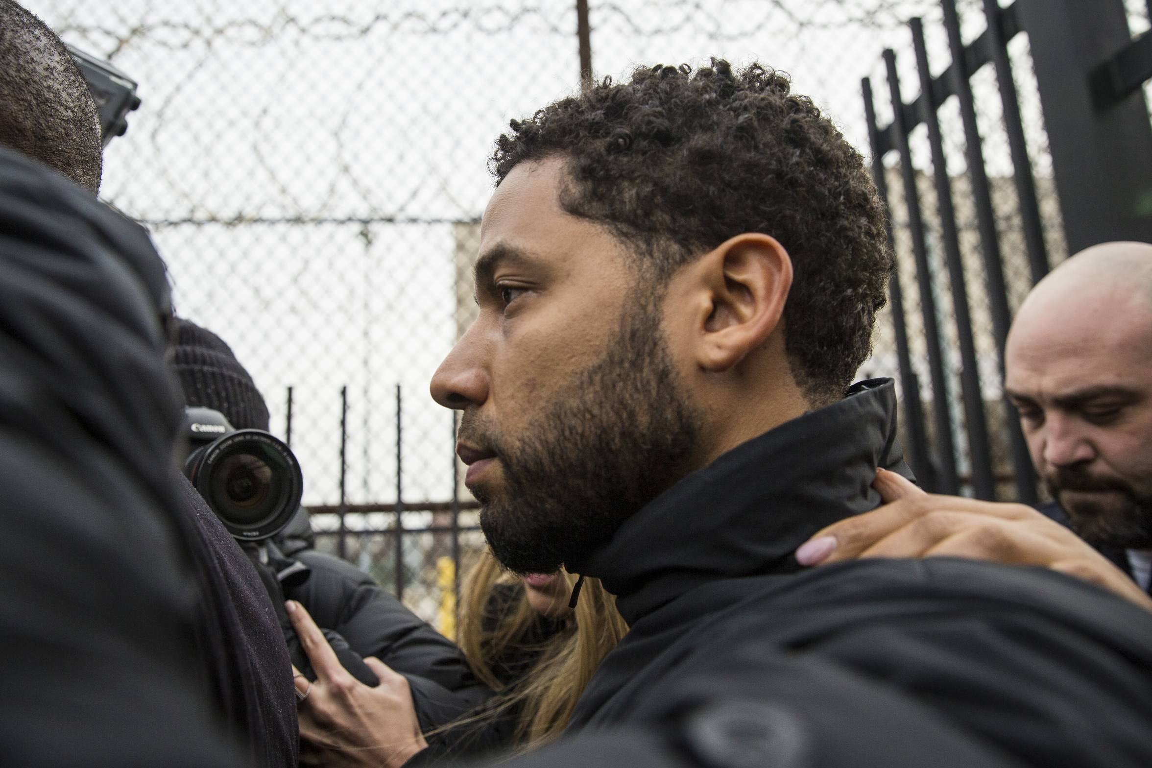 """Empire"" actor Jussie Smollett leaves Cook County jail following his release, Thursday, Feb. 21, 2019, in Chicago. Smollett was charged with disorderly conduct and filling a false police report when he said he was attacked in downtown Chicago by two men who hurled racist and anti-gay slurs and looped a rope around his neck, a police official said."