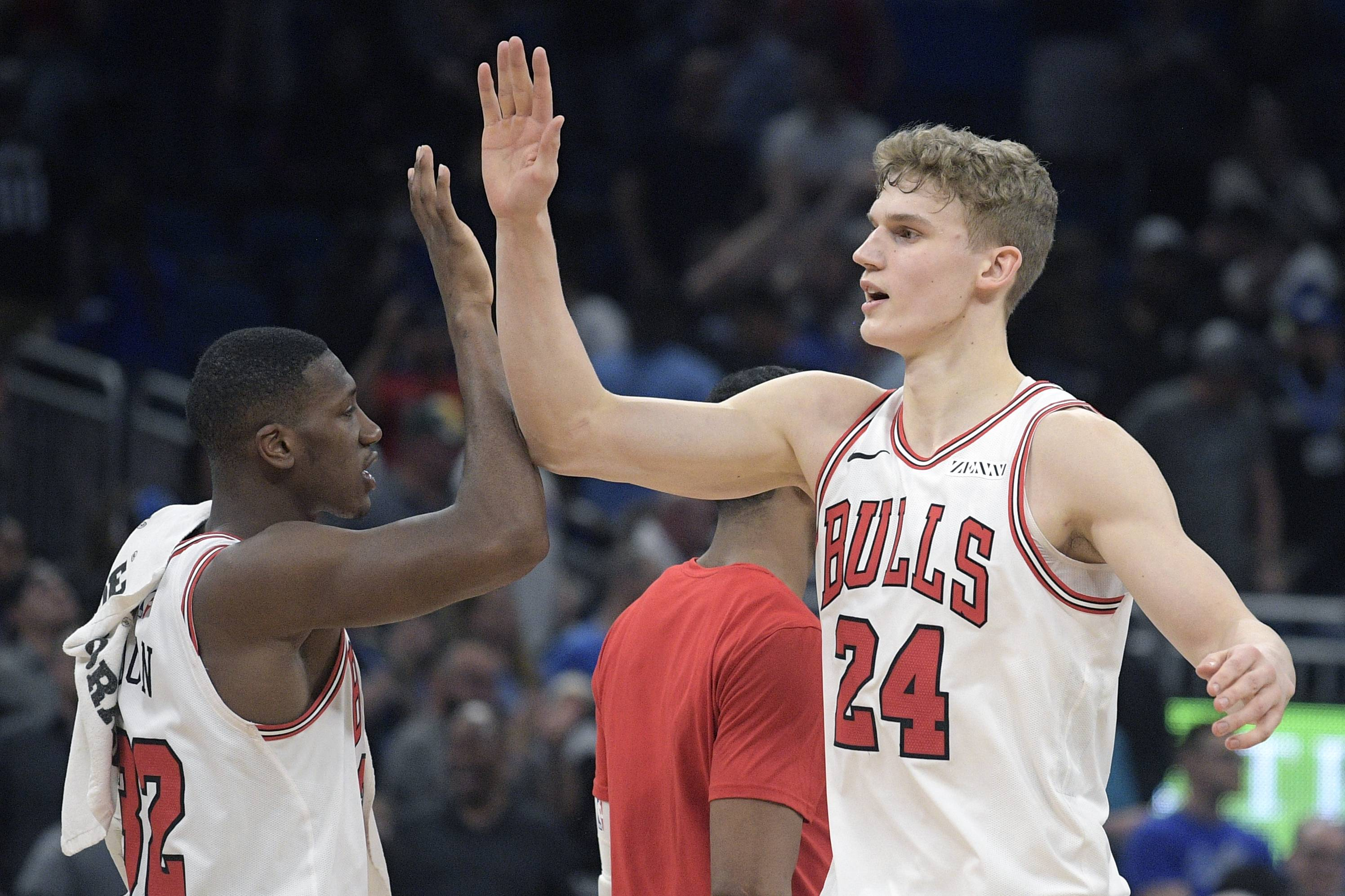 Chicago Bulls forward Lauri Markkanen (24) is congratulated by guard Kris Dunn (32) after a win over the Orlando Magic in an NBA basketball game Friday, Feb. 22, 2019, in Orlando, Fla. (AP Photo/Phelan M. Ebenhack)