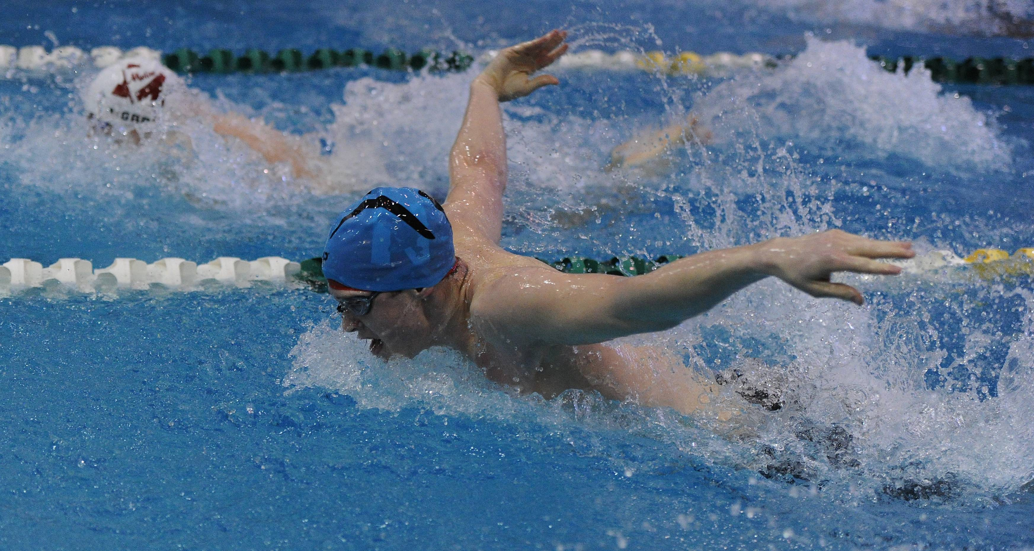Owen Codo of Naperville Central swims the 100-yard butterfly.