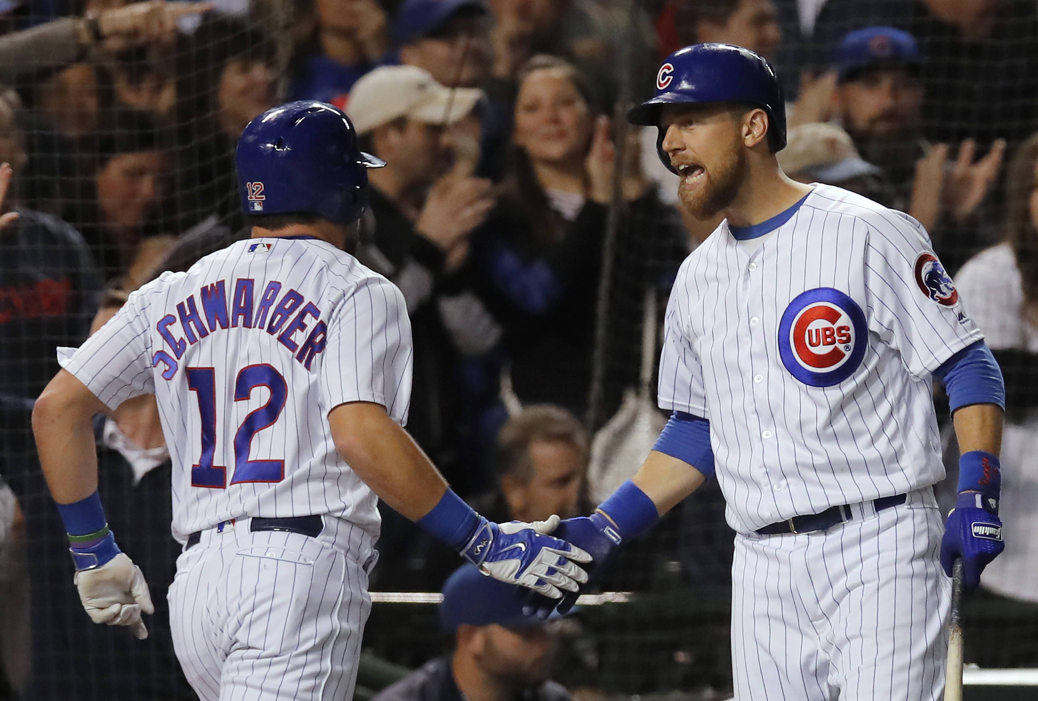 The Chicago Cubs' Ben Zobrist, at right celebrating with Kyle Schwarber late last season, reported to the team's spring-training camp Friday ready to help with some veteran leadership.