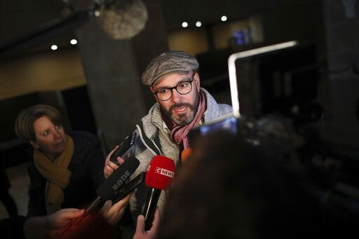 "FILE - In this Jan.7 2019 file photo, Francois Devaux, one of the plaintiffs and President of the ""La Parole Libérée"" (the Liberated Word) Victims' Group and self-declared victim of Father Preynat talks to the media as he arrives to attend the trial of Cardinal Philippe Barbarin at the Lyon courthouse in Lyon, central France. Still coming to terms with their responsibility in the clerical sex abuse scandals that have rocked the Catholic church, French bishops have finally accepted the principle of awarding a financial compensation to victims in France."