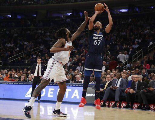 10624ca67071ac Minnesota Timberwolves  Taj Gibson (67) shoots over New York Knicks  DeAndre  Jordan