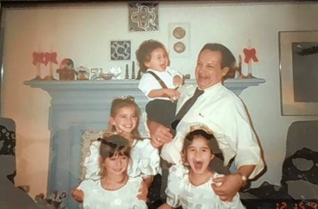 Baheej with four of the six grandchildren, when they were young.