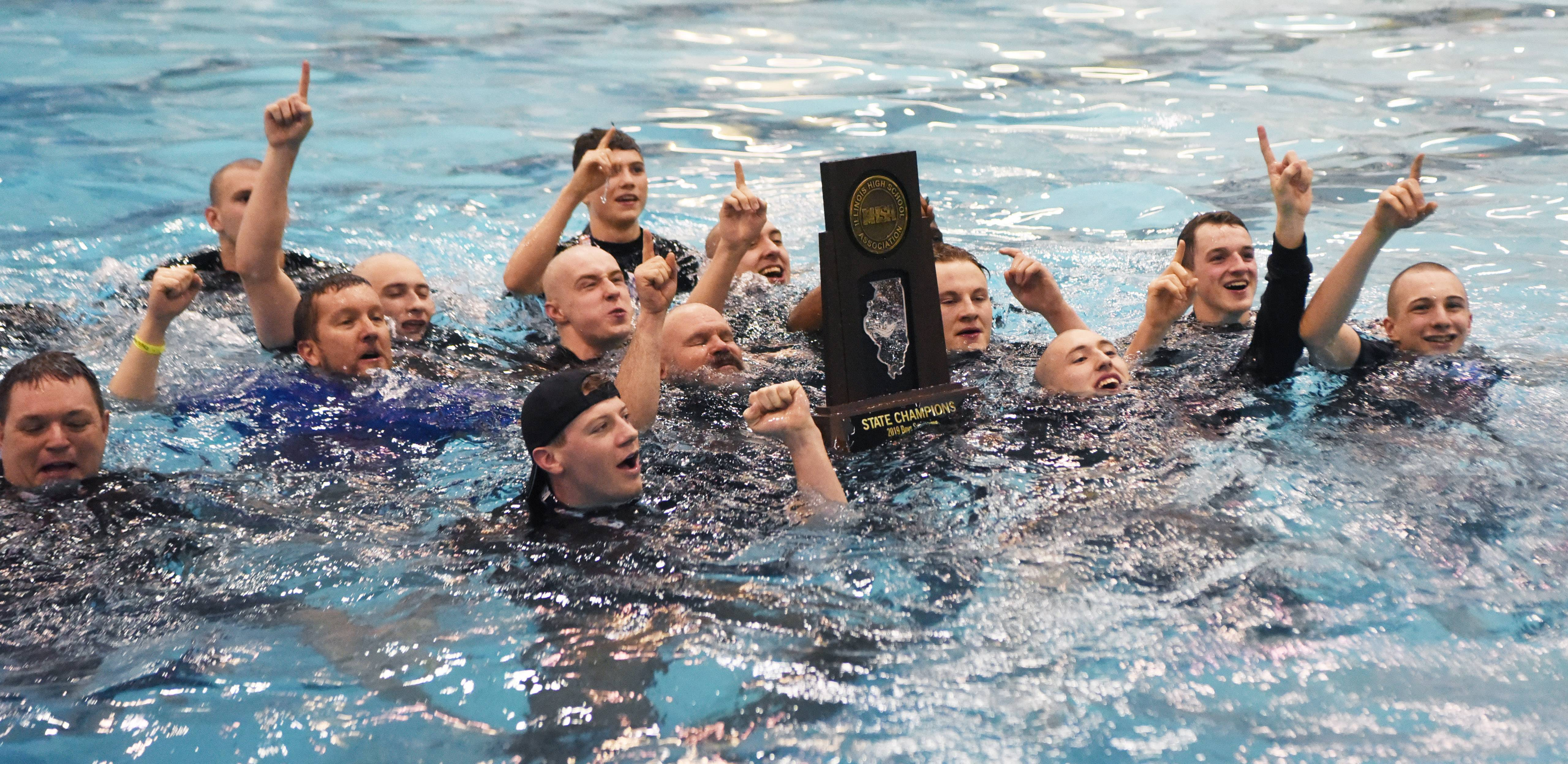 St. Charles North celebrates its state championship during the boys state swimming and diving finals at New Trier High School in Winnetka Saturday.