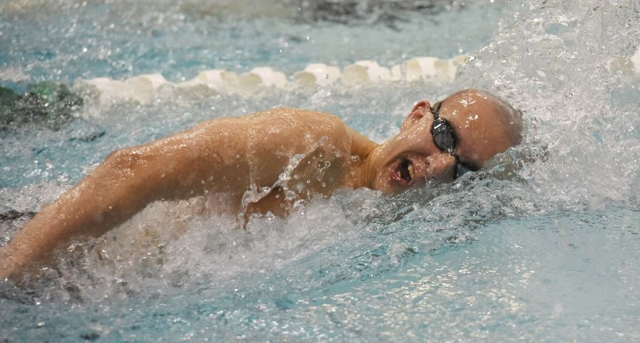 St. Charles North's Ricky Williams swims the 500-yard freestyle during the boys state swimming and diving finals at New Trier High School in Winnetka Saturday.