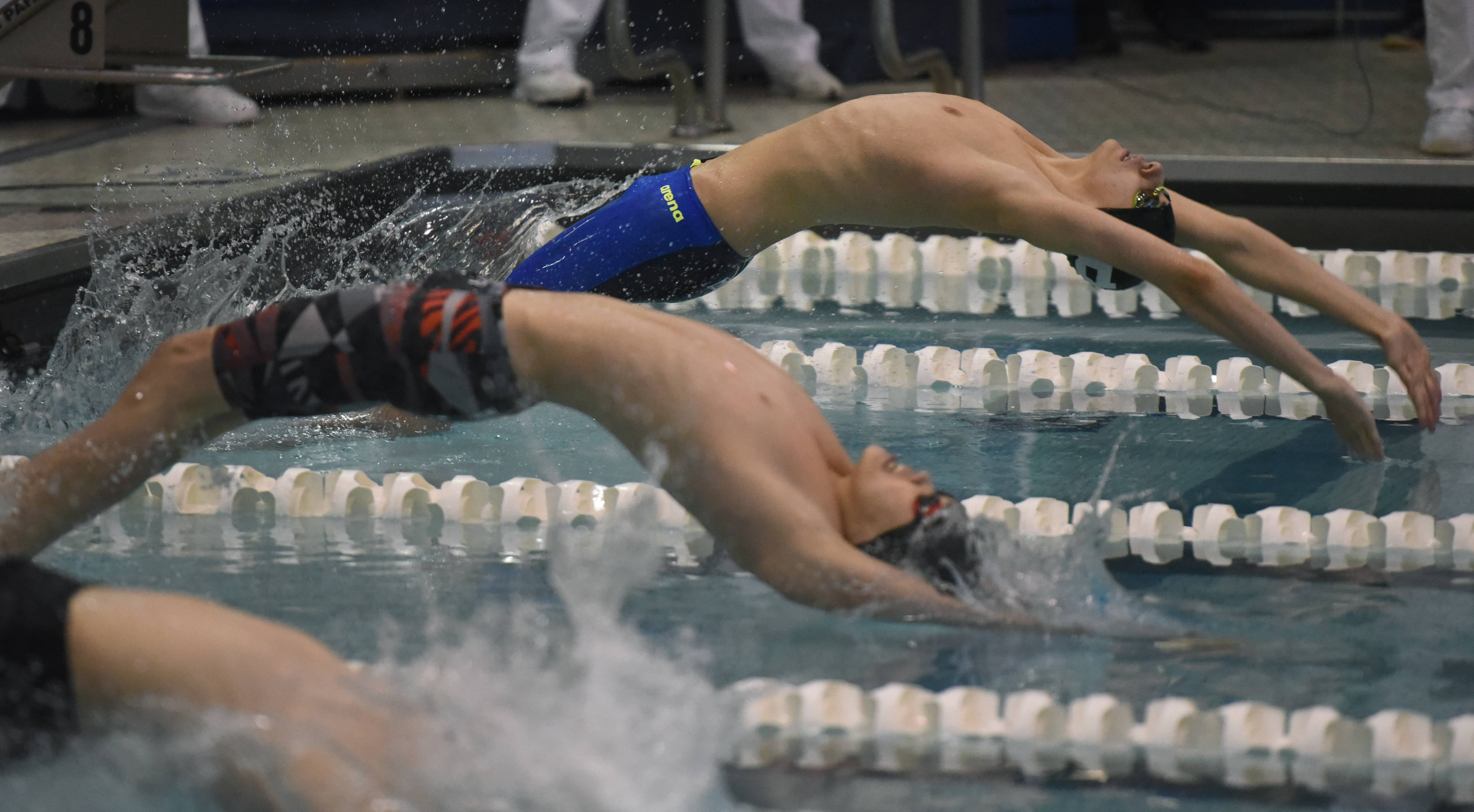 Barrington's Griffin O'Leary, far right, leaves the starting block during the 200-yard medley relay consolation heat of the boys state swimming and diving finals at New Trier High School in Winnetka Saturday.