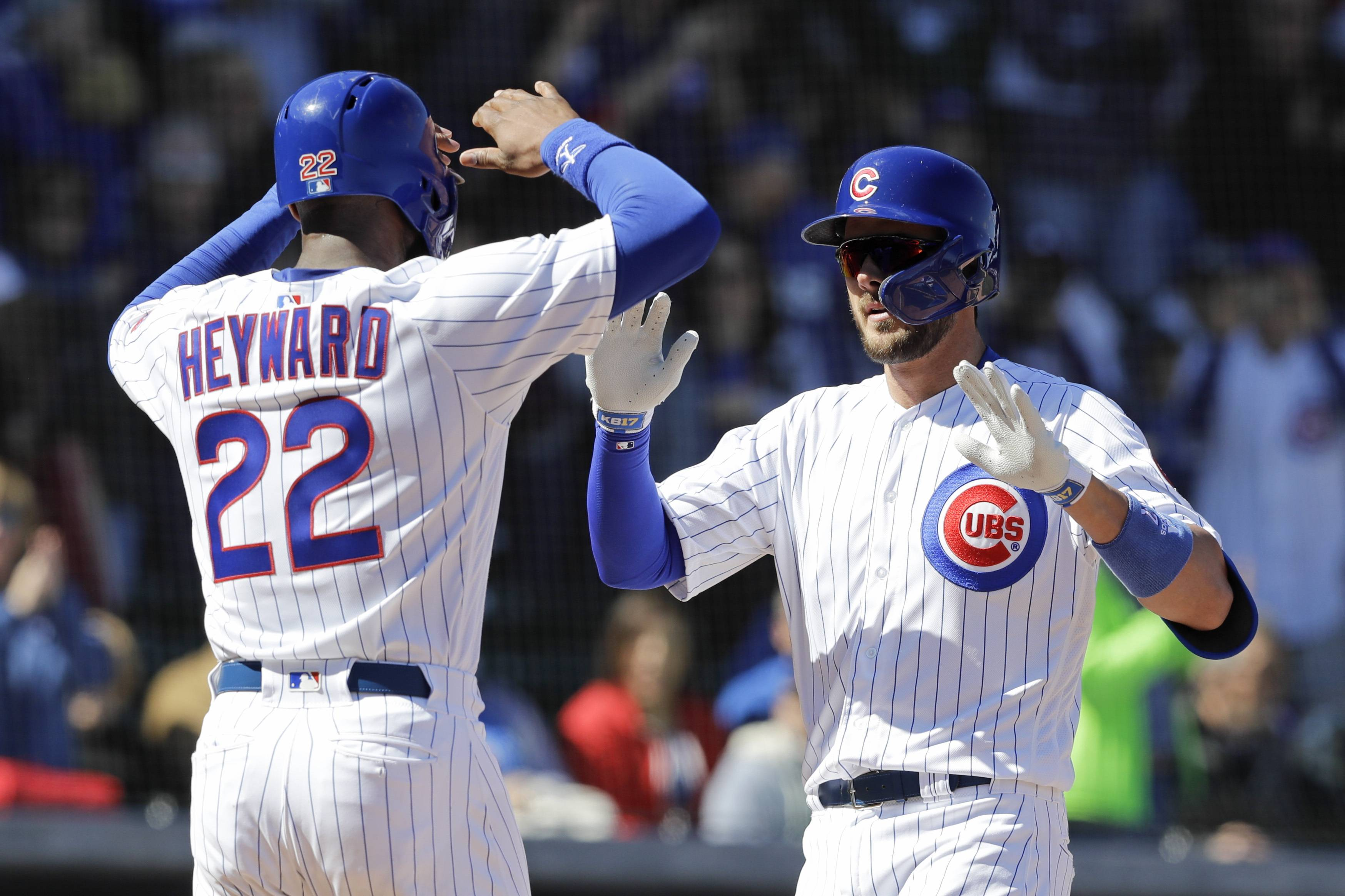 Chicago Cubs' Kris Bryant, right, celebrates with Jason Heyward after hitting a two-run home run during the first inning of a spring training baseball game against the Milwaukee Brewers, Saturday, Feb. 23, 2019, in Mesa, Ariz. (AP Photo/Darron Cummings)
