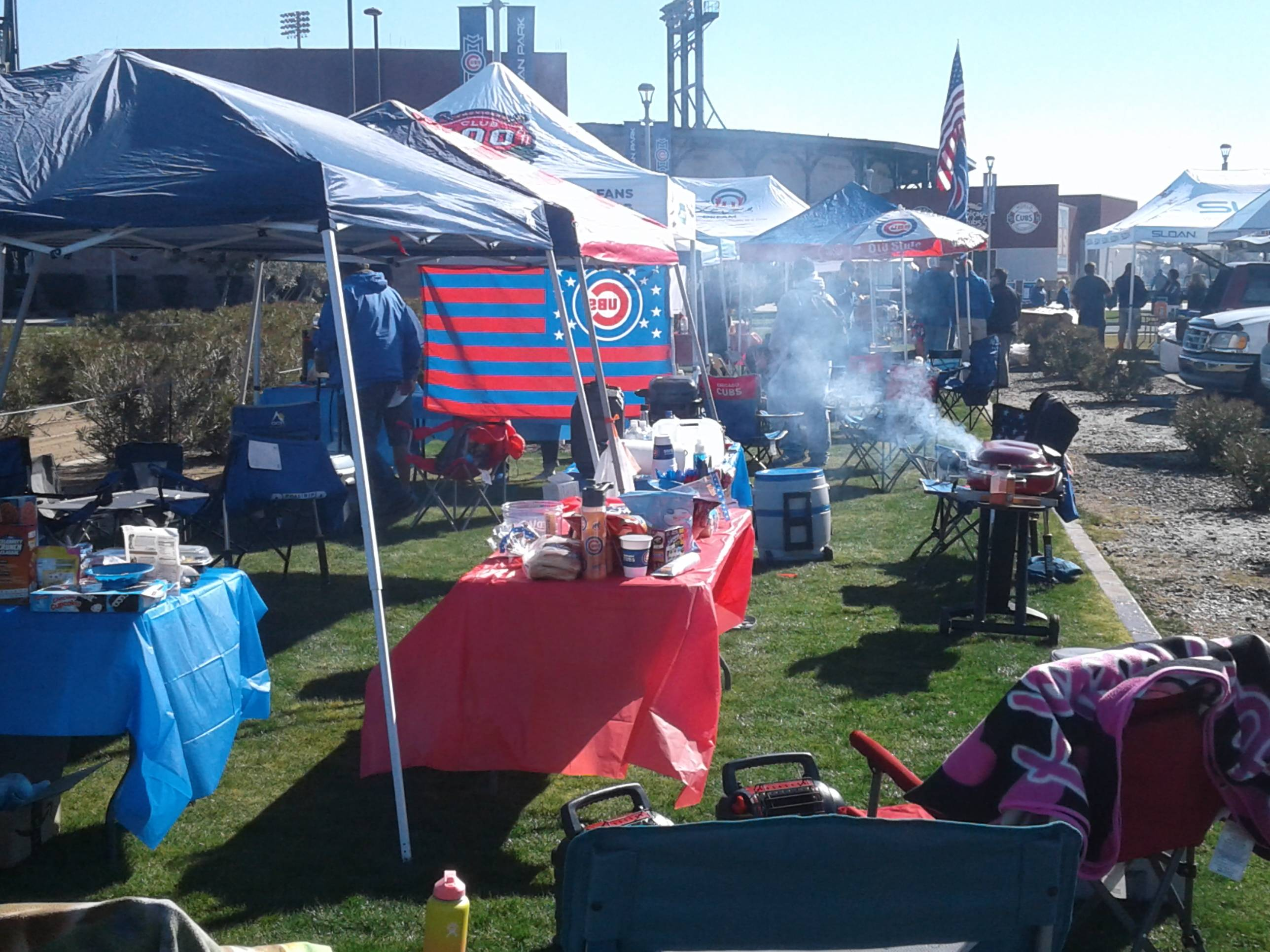 Fans tailgating before Saturday's Cactus League Cubs home opener against the Brewers at Sloan Park.