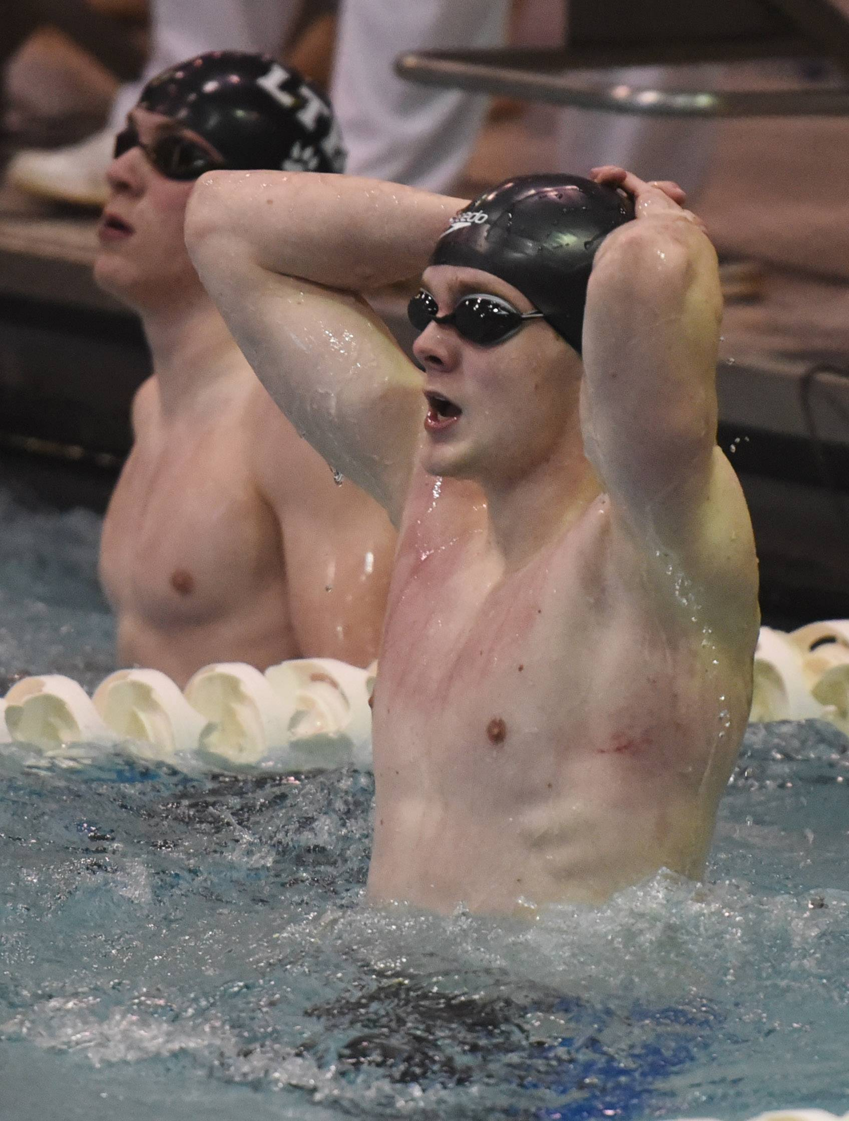 Stevenson's Topher Stensby reacts to his team's third-place finish in the 200-yard freestyle relay during the boys state swimming and diving finals at New Trier High School in Winnetka Saturday.
