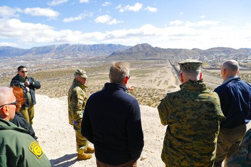 Acting Secretary of Defense Patrick Shanahan, center, and Joint Chiefs Chairman Gen. Joseph Dunford, second from the right, looks across the horizon during a tour of the US-Mexico border at Santa Teresa Station in Sunland Park, N.M., Saturday, Feb. 23, 2019. Top defense officials toured sections of the U.S.-Mexico border Saturday to see how the military could reinforce efforts to block drug smuggling and other illegal activity, as the Pentagon weighs diverting billions of dollars for President Donald Trump's border wall.