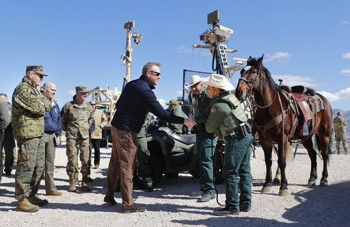 Acting Secretary of Defense Patrick Shanahan, center, greets Border Patrol Agents Carlos Lerma, second from the right, Moises Gonzalez, right, and the horse they use for patrols during a tour of the US-Mexico border at Santa Teresa Station in Sunland Park, N.M., Saturday, Feb. 23, 2019. On the far left is Joint Chiefs Chairman Gen. Joseph Dunford. Top defense officials toured sections of the U.S.-Mexico border Saturday to see how the military could reinforce efforts to block drug smuggling and other illegal activity, as the Pentagon weighs diverting billions of dollars for President Donald Trump's border wall.