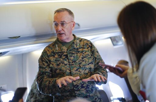 Joint Chiefs Chairman Gen. Joseph Dunford gestures while speaking to reporters during a briefing on a military aircraft before arrival at El Paso International airport, Saturday, Feb. 23, 2019. Dunford is traveling with Acting Secretary of Defense Patrick Shanahan and they are planning to pay a visit to Texas-Mexico border.