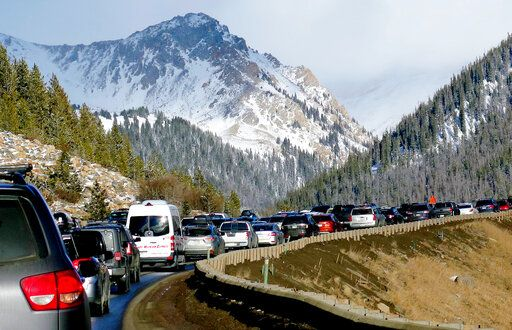 FILE - In this Jan. 7, 2018, file photo, traffic backs up on Interstate 70 near Silverthorne, Colo., a familiar scene on the main highway connecting Denver to the mountains. Heavy ski traffic along the interstate has been common for years, but Colorado's recent population boom is making it increasingly challenging for transportation officials who deal with a bare-bones budget.