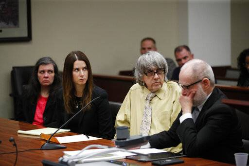 "David Turpin, second from right, and wife, Louise, far left, listen to their charges as they are joined by their attorneys, Allison Lowe, second from left, and David Macher during a courtroom hearing, Friday, Feb. 22, 2019, in Riverside, Calif. The California couple who shackled some of their 13 children to beds and starved them pleaded guilty Friday to torture and other abuse in a case dubbed a ""house of horrors."""