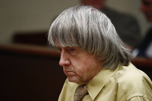 David Turpin sits in a courtroom Friday, Feb. 22, 2019, in Riverside, Calif. Turpin and his wife, Louise, who shackled some of their 13 children to beds and starved them pleaded guilty on Friday to torture and other abuse.