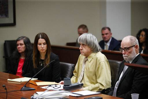 David Turpin, second from right, and wife, Louise, far left, sit in a courtroom with their attorneys, Allison Lowe, second from left, and David Macher Friday, Feb. 22, 2019, in Riverside, Calif. The California couple who shackled some of their 13 children to beds and starved them have pleaded guilty to torture and other abuse.
