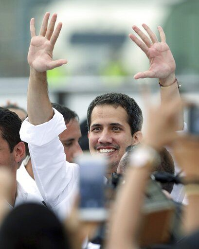 Venezuela's self-proclaimed interim president Juan Guaido, arrives at the Venezuela Aid Live concert on the Colombian side of the Tienditas International Bridge near Cucuta, Colombia, on the border with Venezuela, Friday, Feb. 22, 2019.