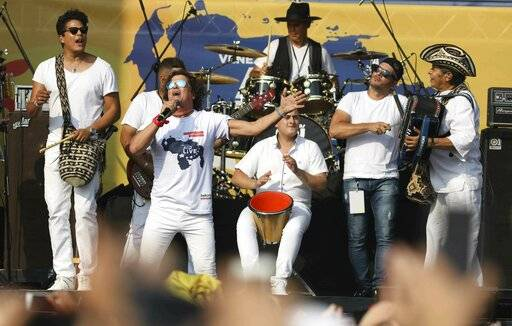 "Carlos Vives performs at the ""Live Aid Venezuela"" concert at the Tienditas International Bridge on the outskirts of Cucuta, Colombia, Friday, Feb. 22, 2019, on the border with Venezuela. British billionaire Richard Branson organized the mega concert, which features dozens of Latin musicians performing on a giant stage on one side of what Colombian authorities have renamed the ""Unity"" bridge."