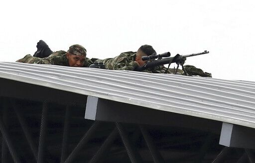 Colombian Army snipers cover the Venezuela Aid Live concert on the Colombian side of the Tienditas International Bridge near Cucuta, Colombia, on the border with Venezuela, Friday, Feb. 22, 2019.