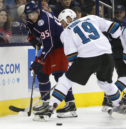 Columbus Blue Jackets' Matt Duchene, left, tries to clear the puck past San Jose Sharks' Joe Thornton during the first period of an NHL hockey game Saturday, Feb. 23, 2019, in Columbus, Ohio.