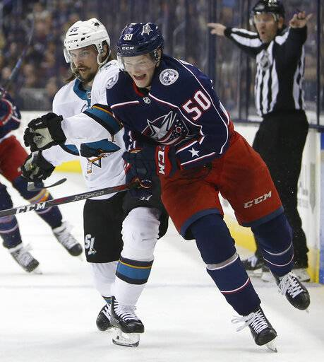 San Jose Sharks' Erik Karlsson, left, of Sweden, and Columbus Blue Jackets' Eric Robinson chase the puck during the second period of an NHL hockey game Saturday, Feb. 23, 2019, in Columbus, Ohio.