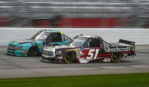 Kyle Busch (51) and Johnny Sauter run side by side during the NASCAR Truck Series auto race at Atlanta Motor Speedway, Saturday, Feb. 23, 2019, in Hampton, Ga.