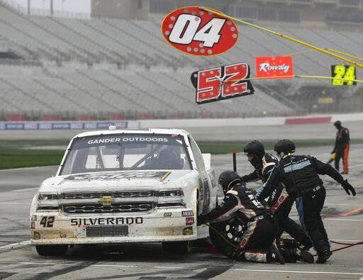 Chad Finley makes a pit stop during the NASCAR Truck Series auto race at Atlanta Motor Speedway, Saturday, Feb. 23, 2019, in Hampton, Ga.