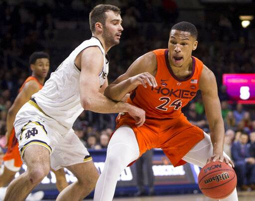 Virginia Tech's Kerry Blackshear Jr., right, is defended by Notre Dame's John Mooney during the first half of an NCAA college basketball game Saturday, Feb. 23, 2019, in South Bend, Ind.