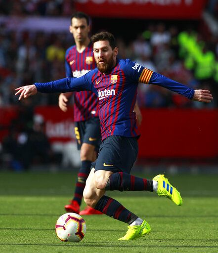 Barcelona forward Lionel Messi kicks the ball during La Liga soccer match between Sevilla and Barcelona at the Ramon Sanchez Pizjuan stadium in Seville, Spain. Saturday, February 23, 2019.