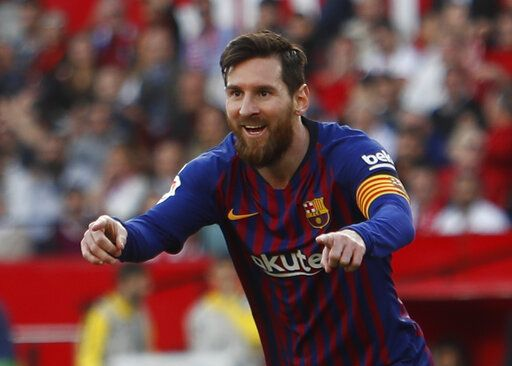 Barcelona forward Lionel Messi celebrates after scoring his side's second goal during La Liga soccer match between Sevilla and Barcelona at the Ramon Sanchez Pizjuan stadium in Seville, Spain. Saturday, February 23, 2019.