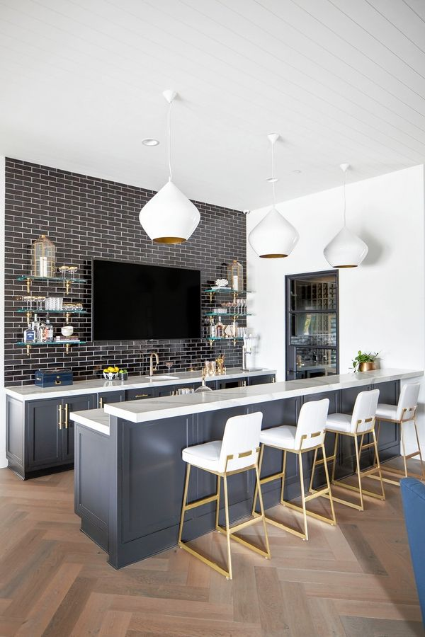 This bar area incorporates black in the cabinetry (Sherwin Williams color: SW7069 Iron Ore) and backsplash to bring in a soft black look that doesn't feel too harsh with the backsplash, quartz countertops or white elements.