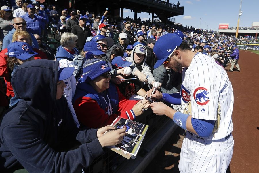 Chicago Cubs' Kris Bryant signs autographs before a spring training baseball game against the Milwaukee Brewers, Saturday, Feb. 23, 2019, in Mesa, Ariz.