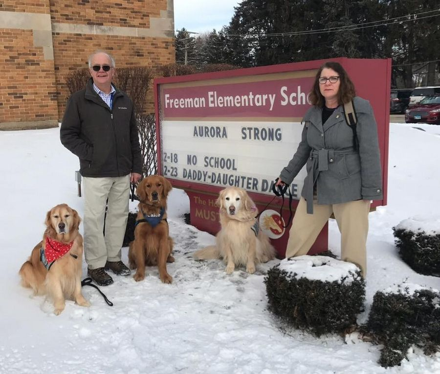 Golden retrievers from the Lutheran Church Charities K-9 Comfort Dog Ministry and their handlers recently visited schools, churches and first responders in Aurora. From left are comfort dog Adeena, Don Tursman with comfort dog Caleb, and Deb Anderson with Ladel.