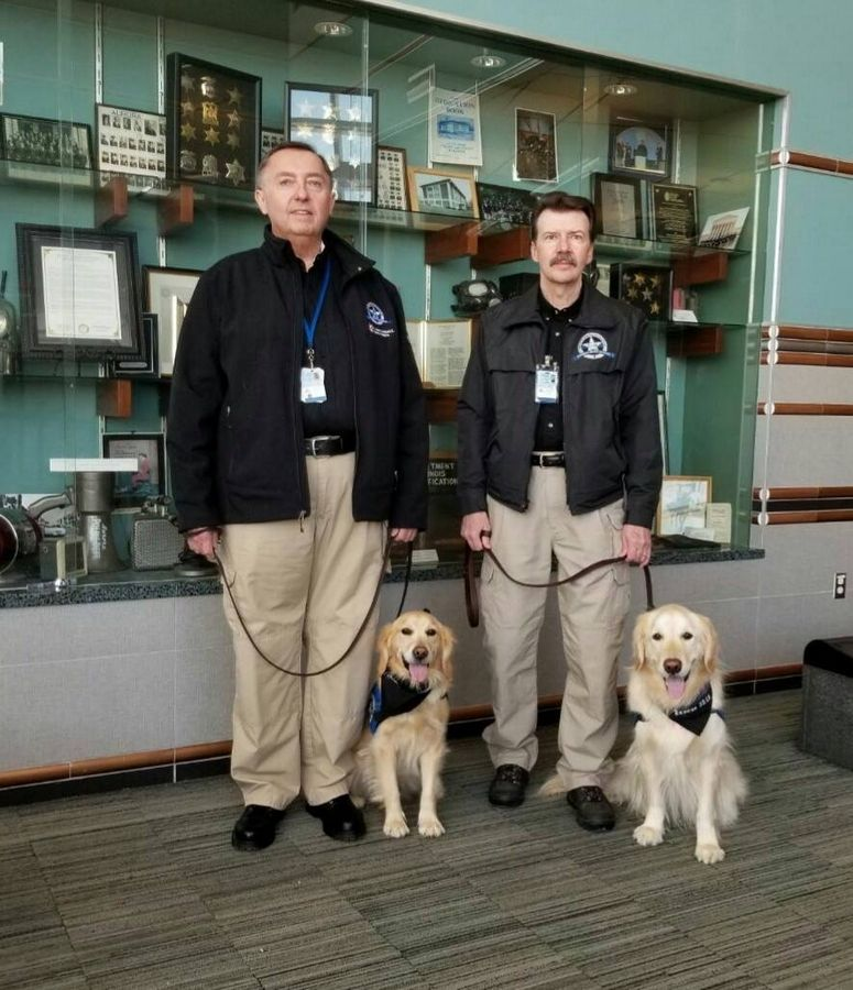 Golden retrievers from the Lutheran Church Charities K-9 Comfort Dog Ministry and their handlers recently visited schools, churches and first responders in Aurora. From left are Mike Millett, law enforcement handler, with Eve, and Patrick Quinn, LCC K-9 Police Ministry Coordinator, with Shiloh.
