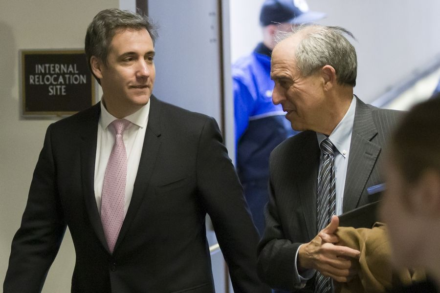 Michael Cohen, left, President Donald Trump's former lawyer, arrives Tuesday to testify before a closed-door hearing of the Senate Intelligence Committee accompanied by his lawyer, Lanny Davis.