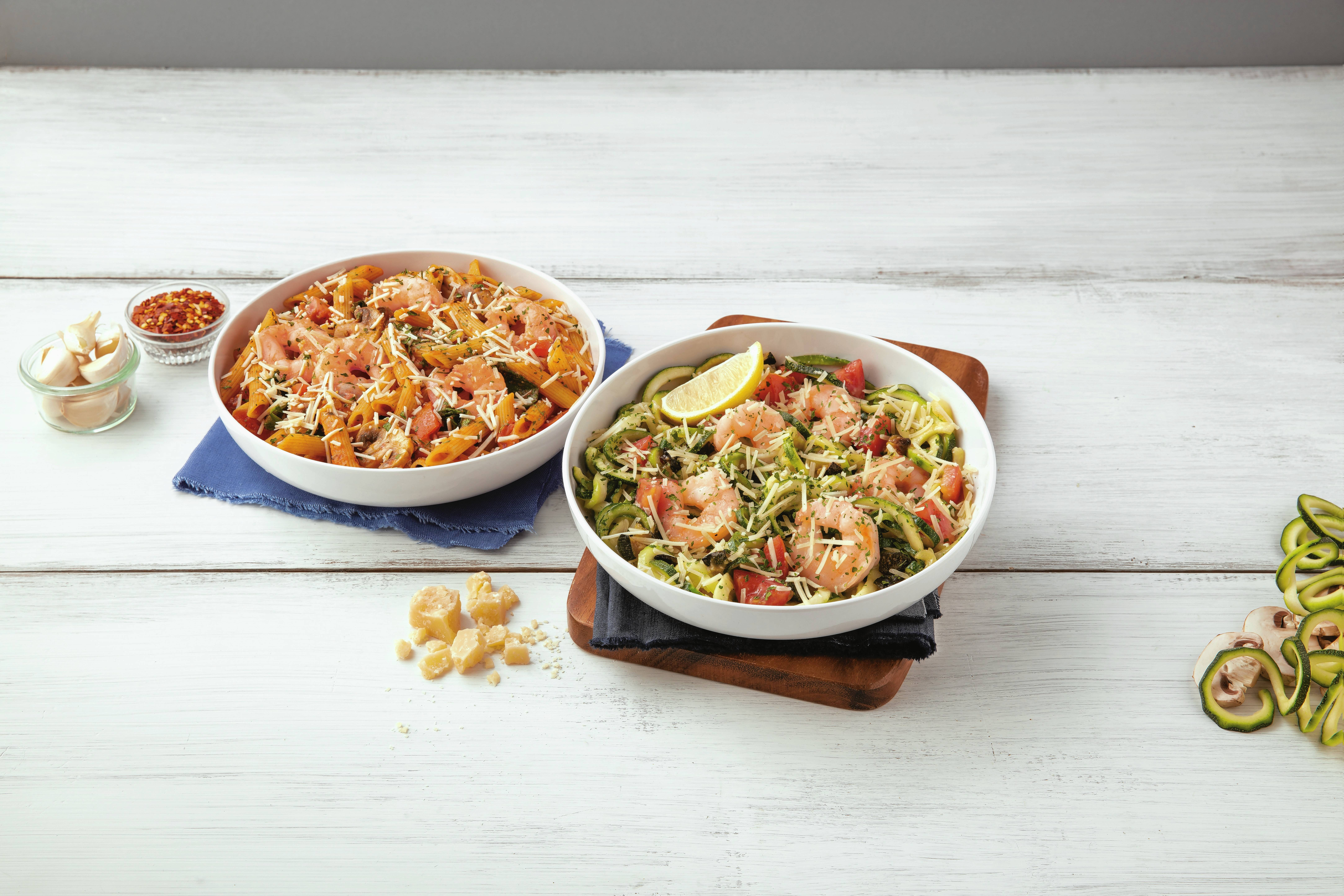 Noodles & Company recently introduced penne rosa with shrimp, left, and zucchini shrimp scampi to its menu.